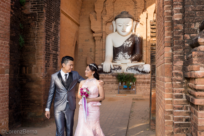 Couple just married, paying homage to the Buddha - photo by Lorenz Berna of Myanmar