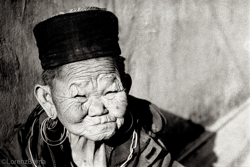 Hmong Old Woman in Sapa, Vietnam - Travel portrait by photographer Lorenz Berna