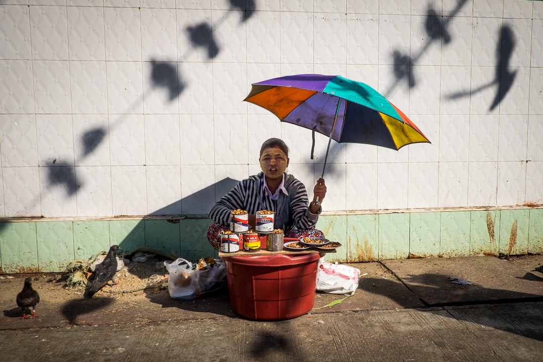Birds seeds seller, Cambodia - Yangon Street Photography by Lorenz Berna