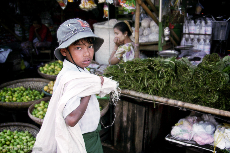 Child working in the market of Bago in Myanmar - photo by Lorenz Berna