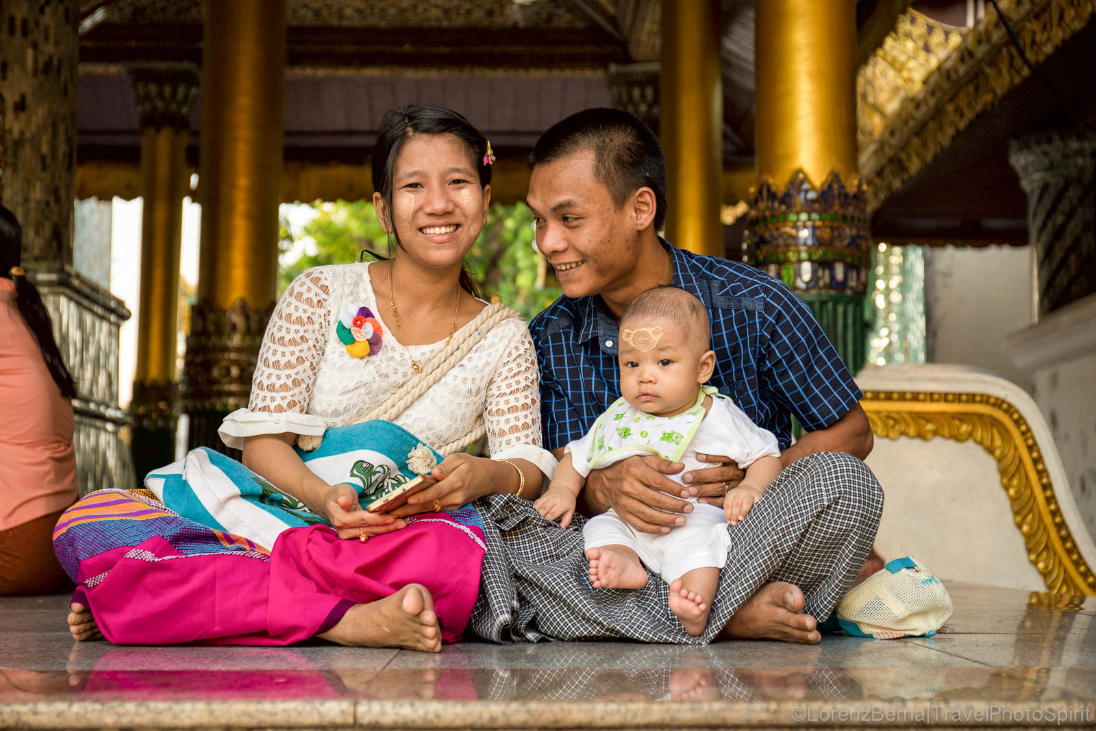 A young burmese couple brought their baby with them to the Shwedagon Paya in Yangon, Myanmar
