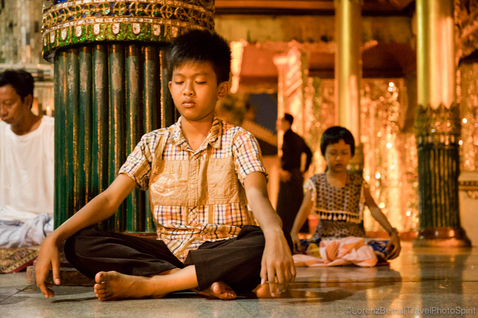 YOung boy in meditation in Myanmar