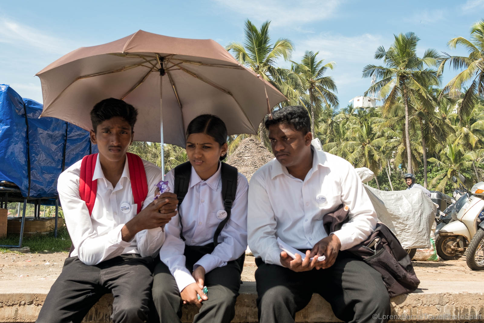 Young people protecting themselves from the sun in Kerala, India