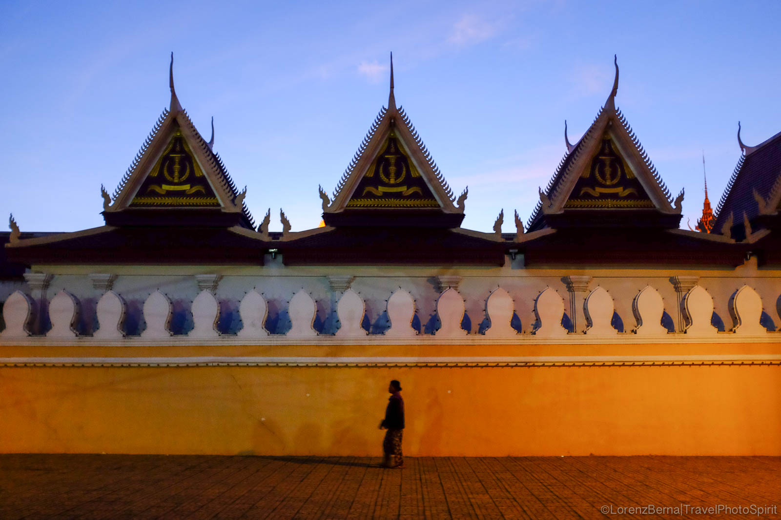 Evening walk alongside the Royal Palace, in Phnom Penh - A Lorenz Berna travel photography of Cambodia