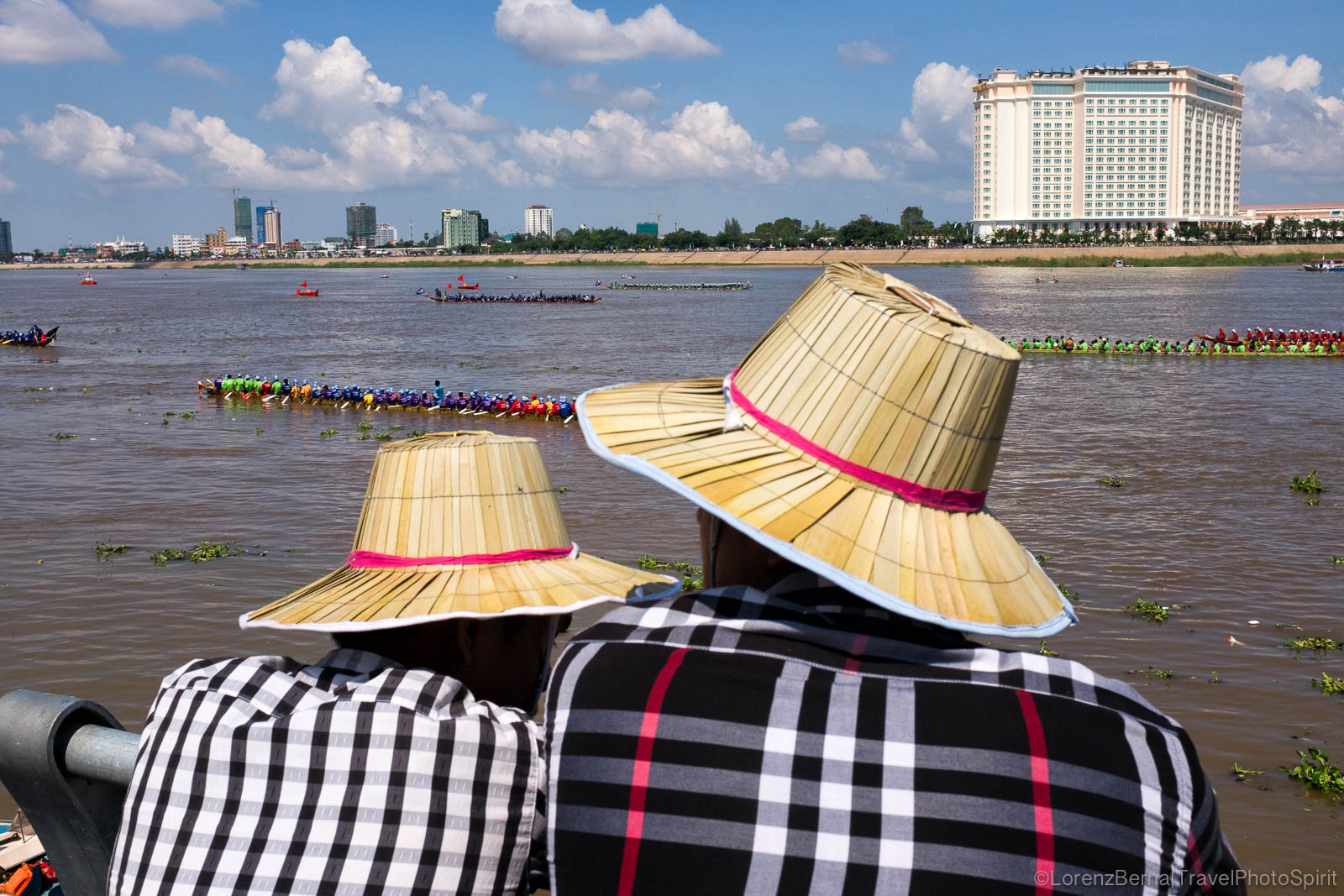 Two Cambodian men at the boat race in Phnom Penh, Cambodia
