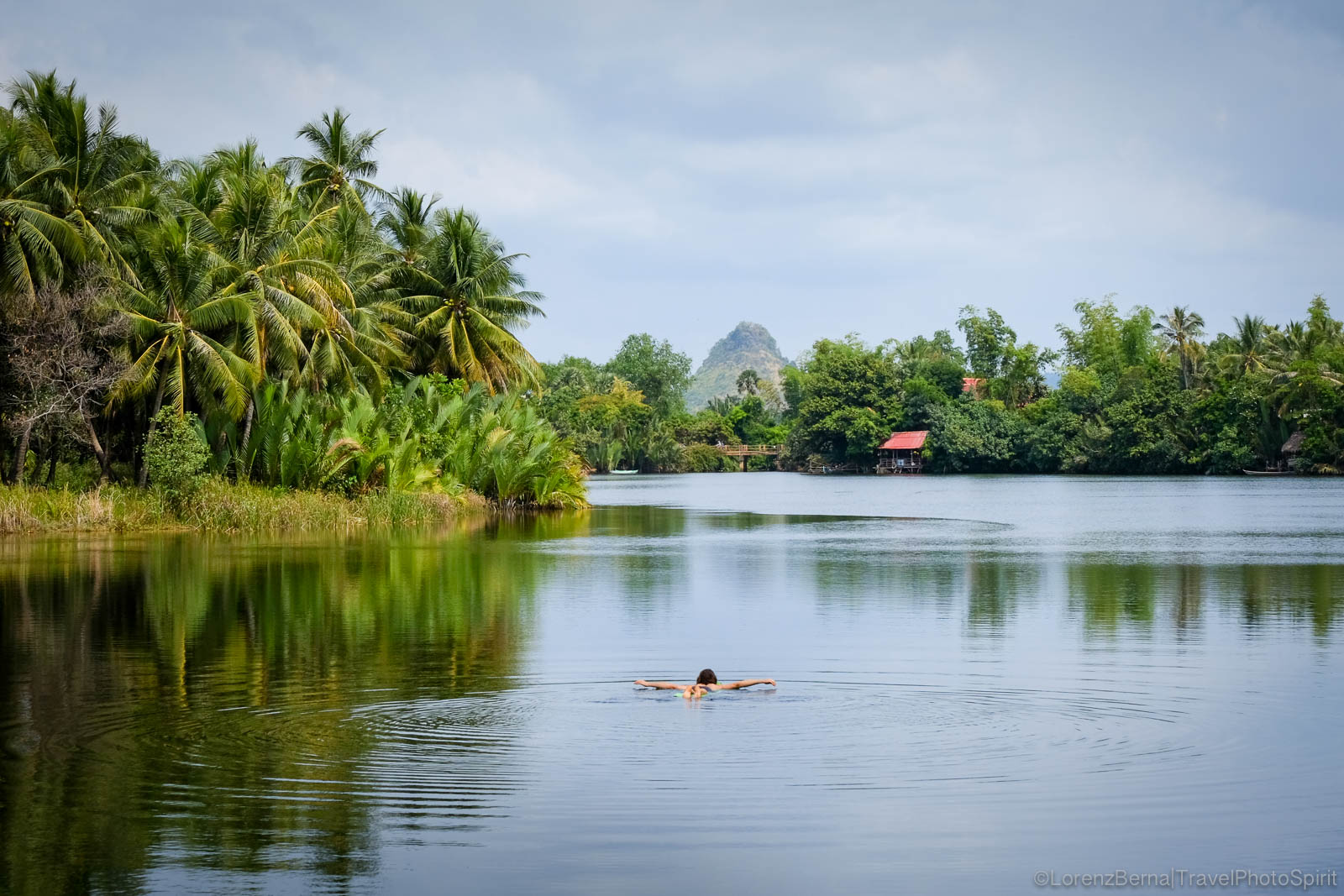 Tourist bathing in Kampot river - A Lorenz Berna Travel Photography of Cambodia