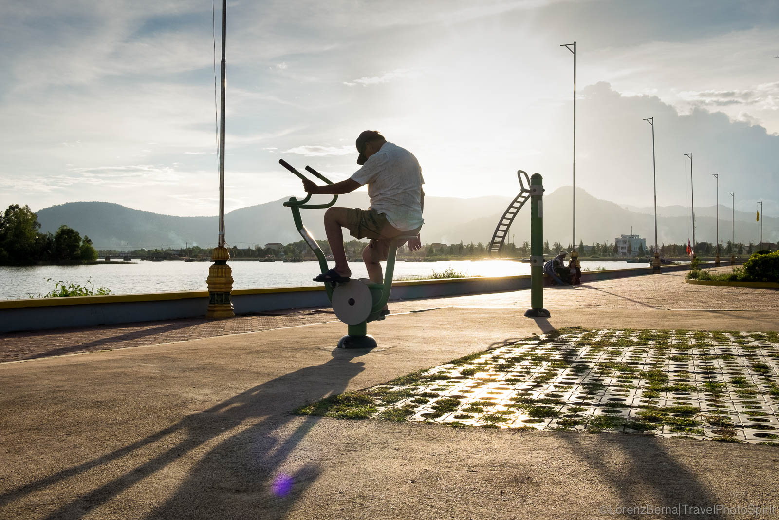 Man exercising on the Kampot riverside public gym, Cambodia