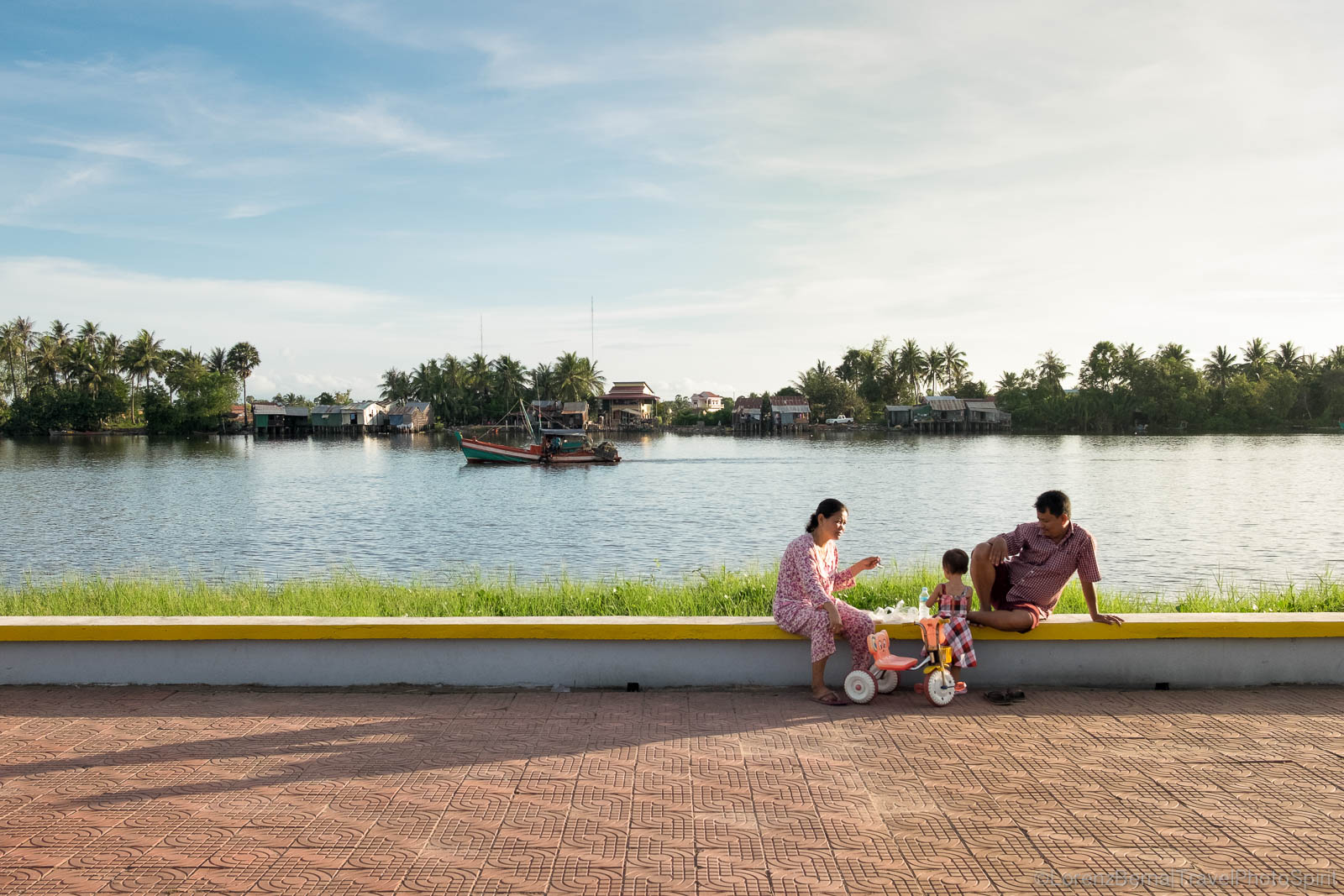Cambodian family on Kampot riverside, Cambodia
