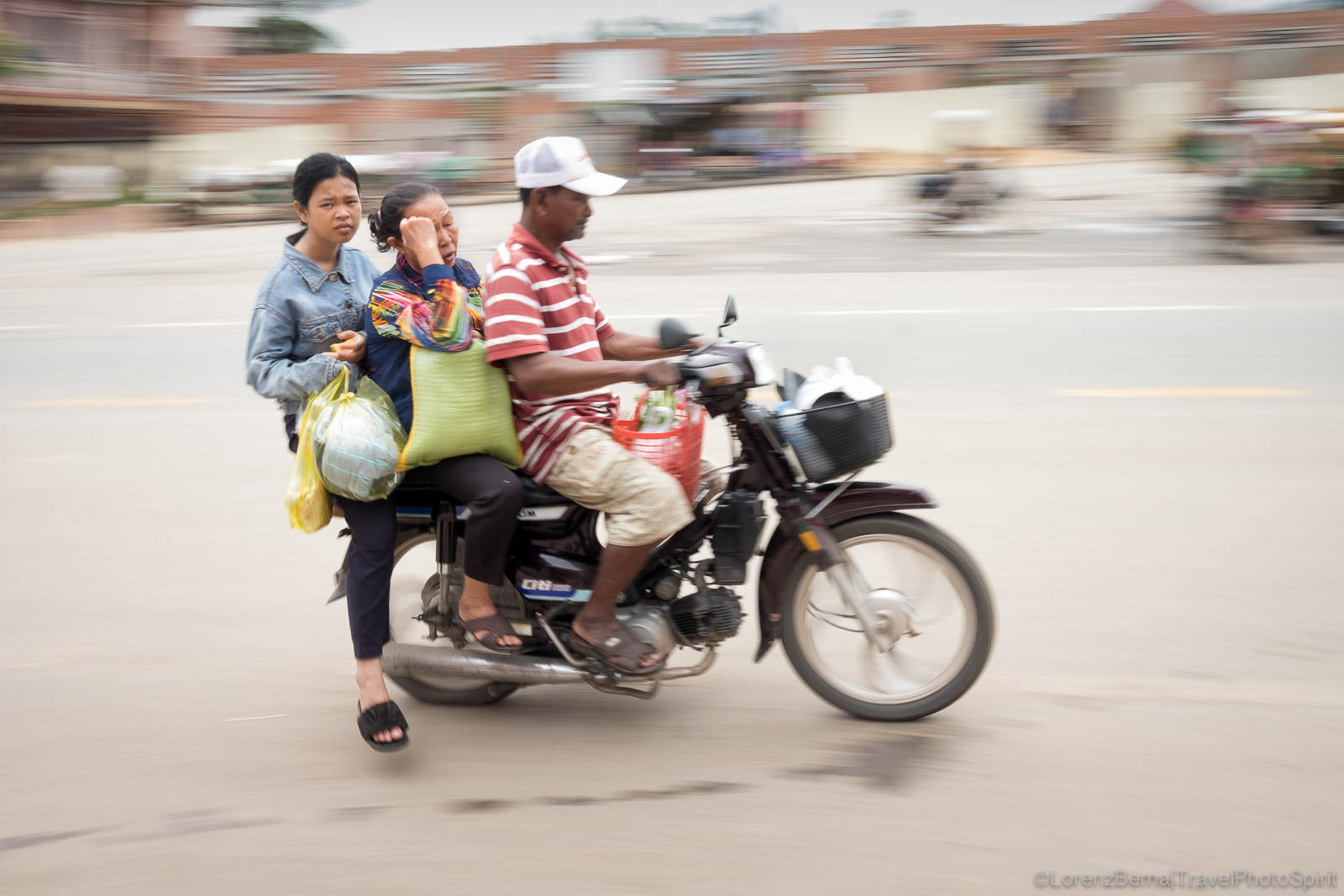 Family on wheels in Kampot, Cambodia.