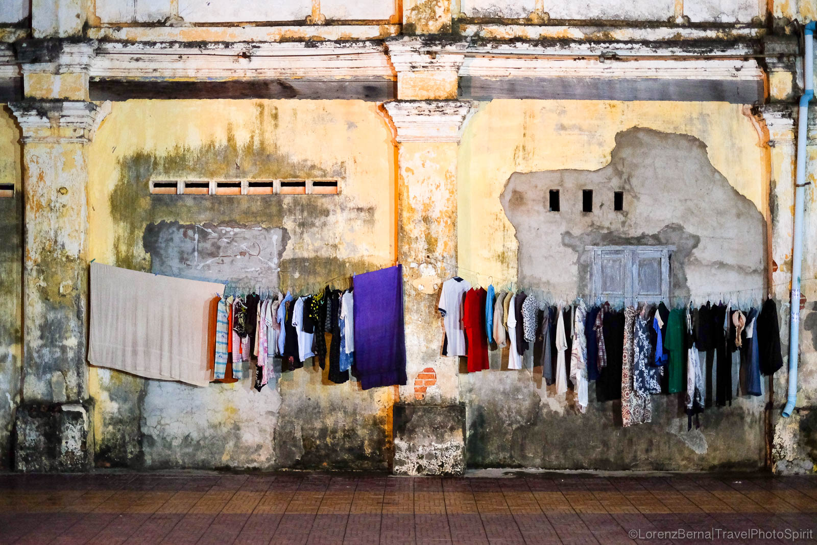 Drying clothes in Kampot along the wall of an old crumbling colonial house, Cambodia