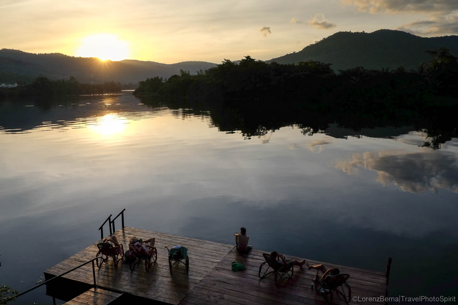 Sunset on a floating deck on Kampot river, South Cambodia