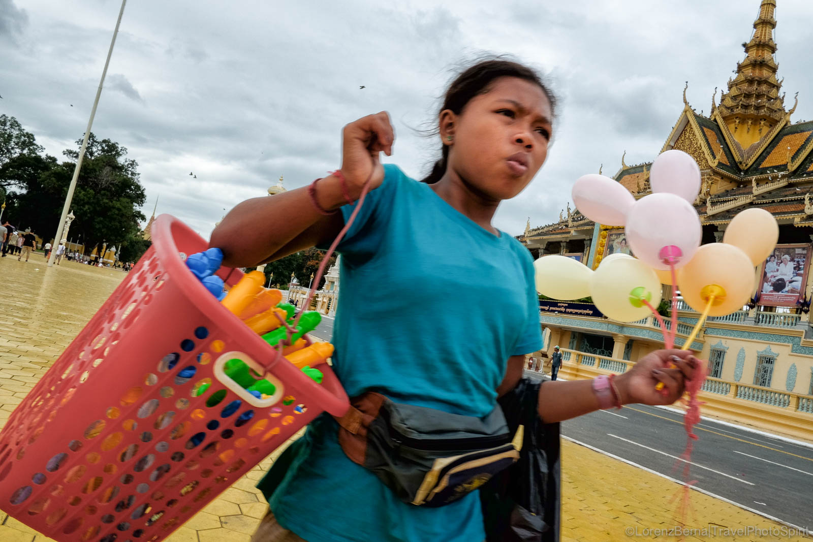 Young balloon and toys seller in front of the Royal Palace, Phnom Penh, Cambodia