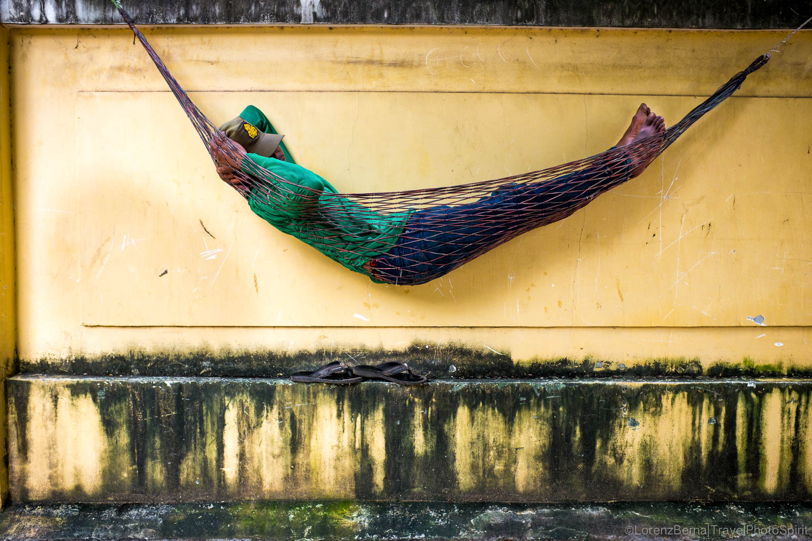 Man sleeping in Hammock in Phnom Penh - A Lorenz Berna Travel Photography of Cambodia