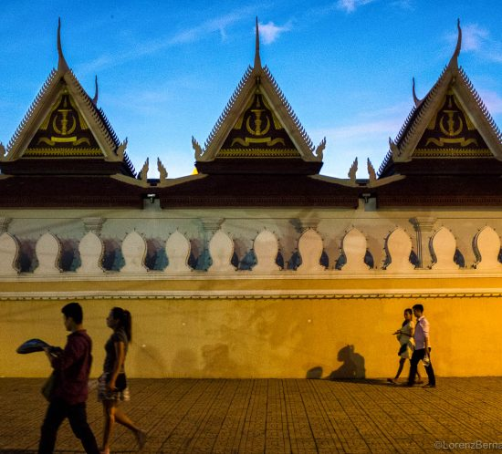 Walking by the Phnom Penh Royal Palace in the evening, Cambodia