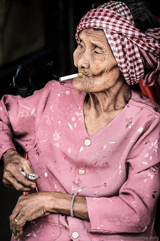 Portrait of an old khmer lady smoking - A Lorenz Berna Travel Photography of Cambodia