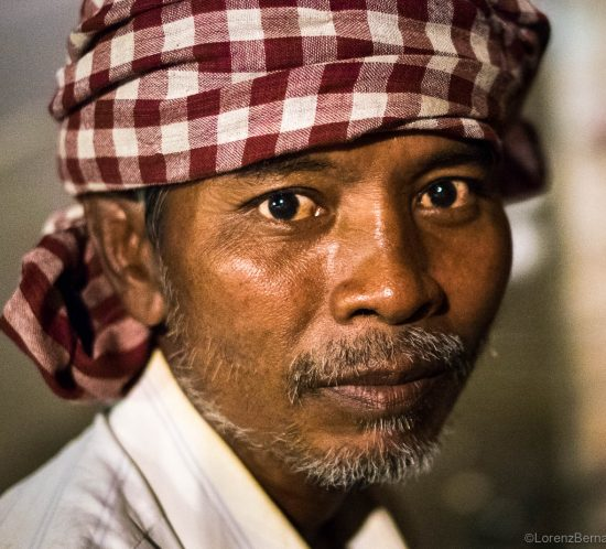 Portrait of a Tuk Tuk driver in Phnom Penh - A Lorenz Berna Photography of Cambodia