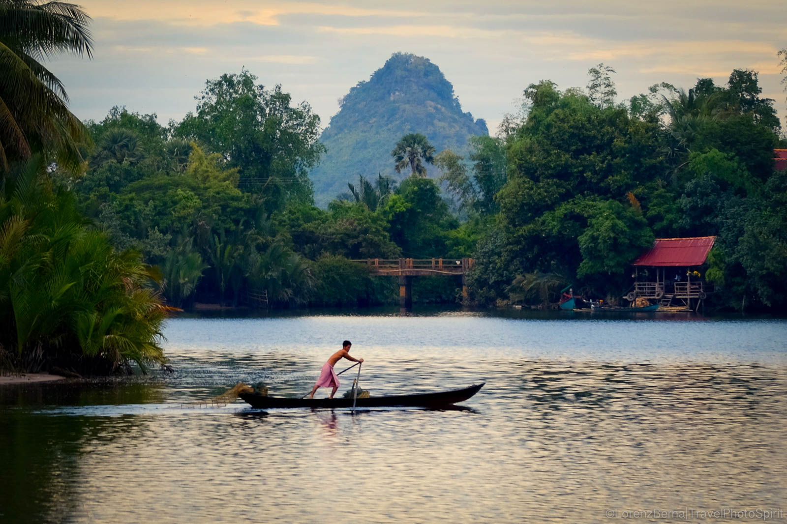 Fisherman on Kampot river with Phnom Sor in background - A Lorenz Berna Travel photography of Cambodia