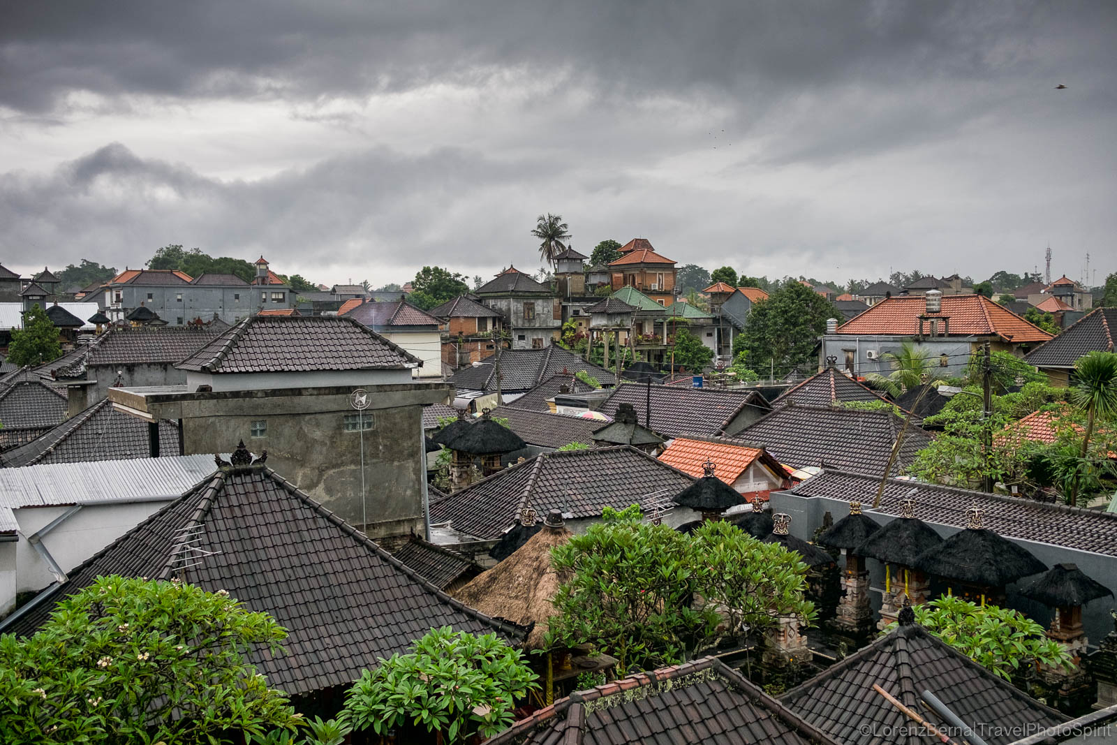 Monsoon sky over Bali's roofs, Indonesia