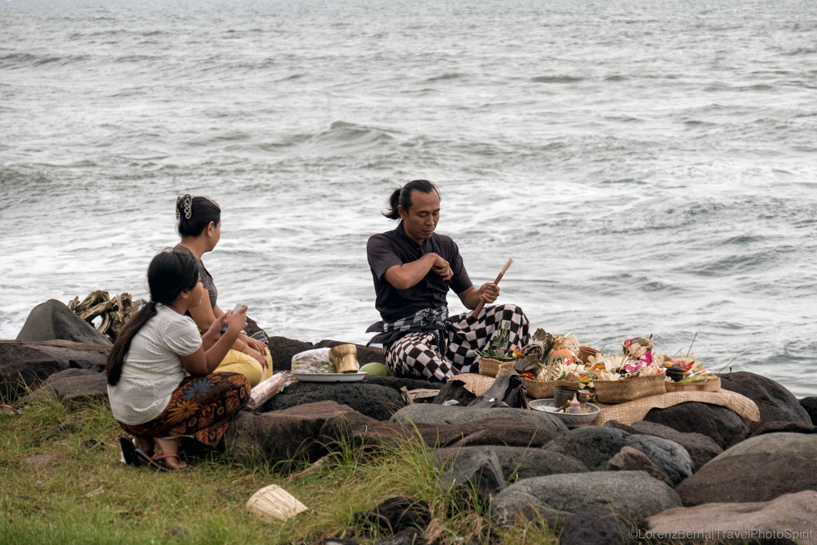 Ceremony of offerings on the Seashore in Bali, Indonesia