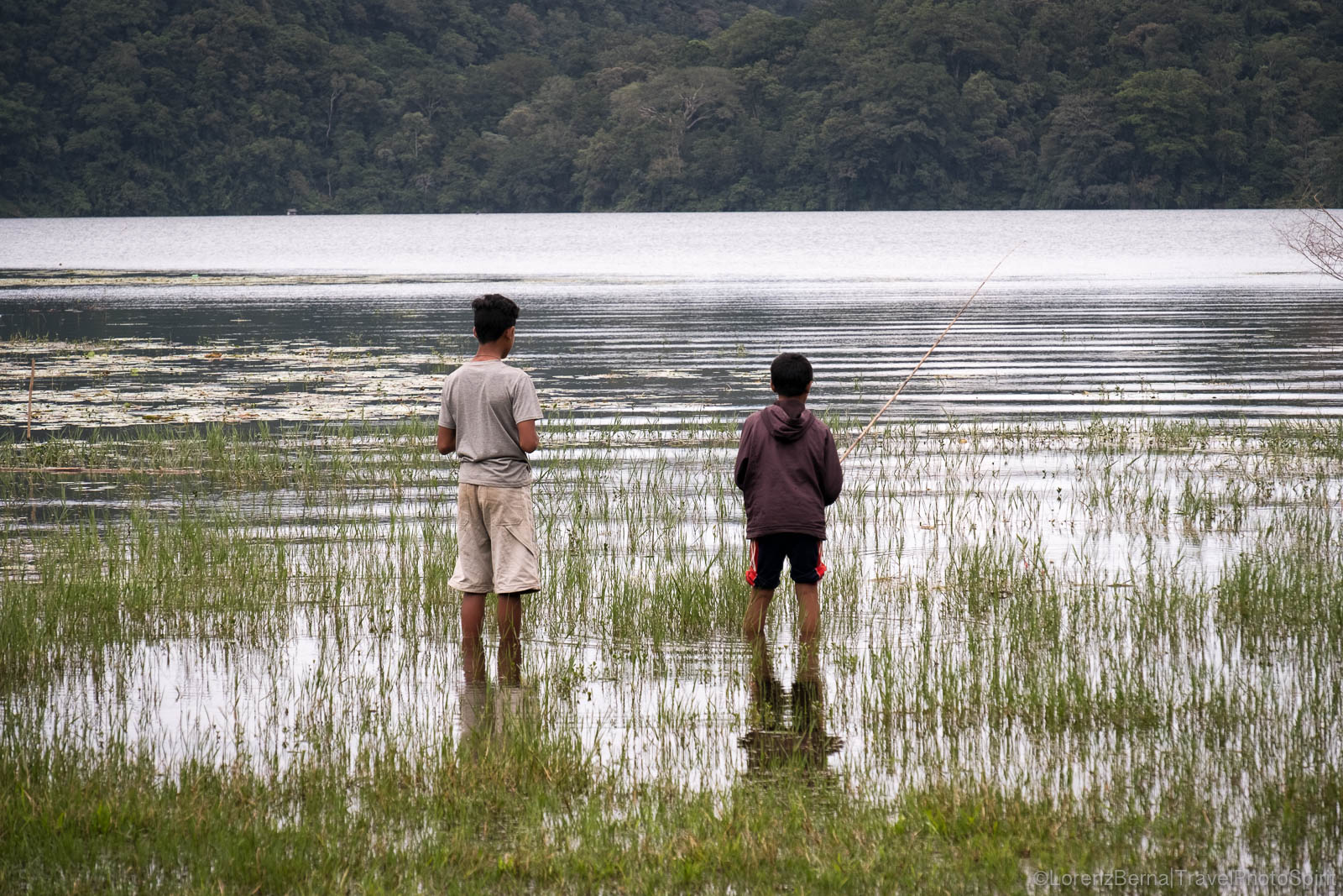 Young fishermen in Tamblingan Lake, Danau Bratan area, Bali, Indonesia.