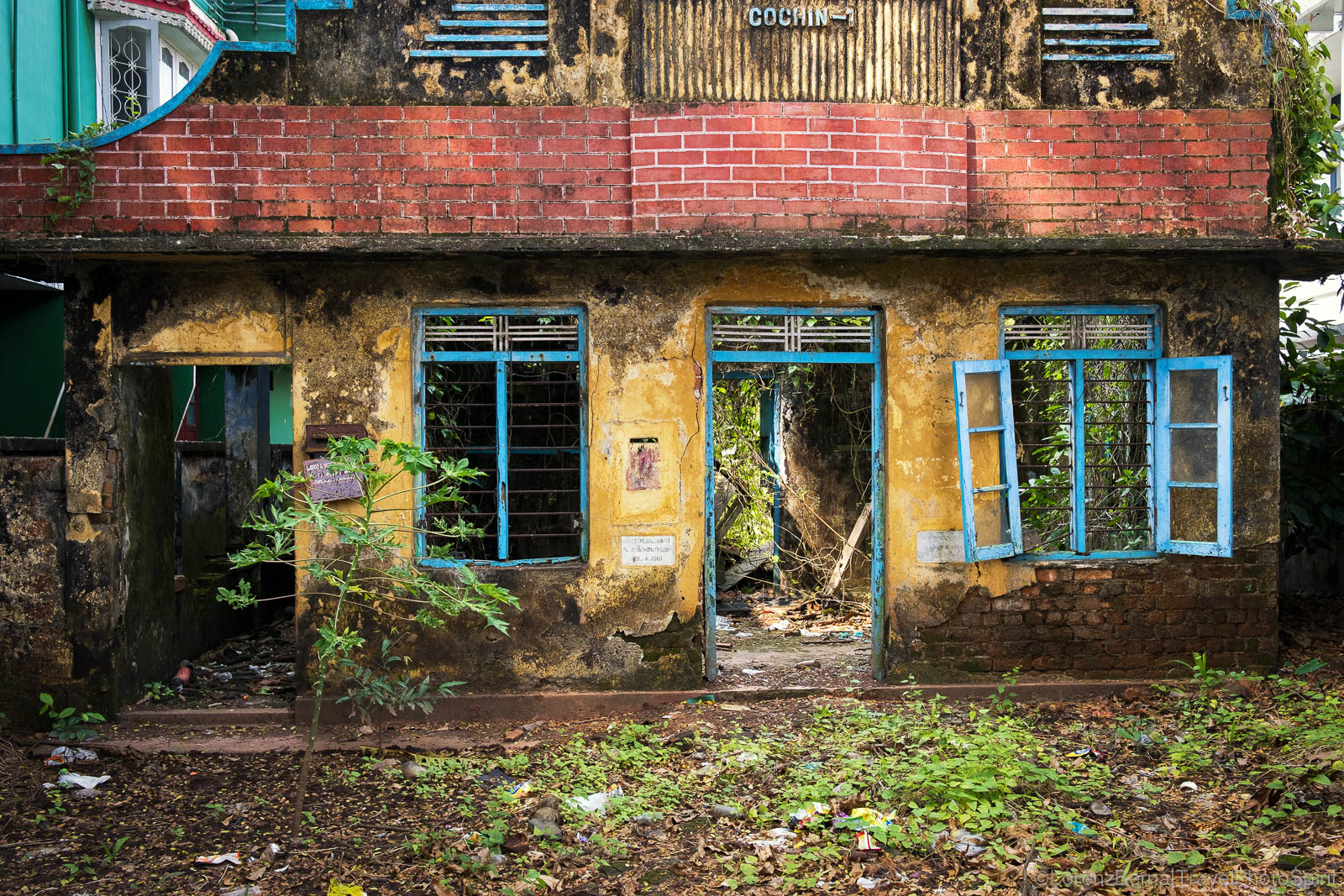 The vegetation is enveloping a colourful colonial abandoned house in the heart of Fort Kochi, Kerala, India