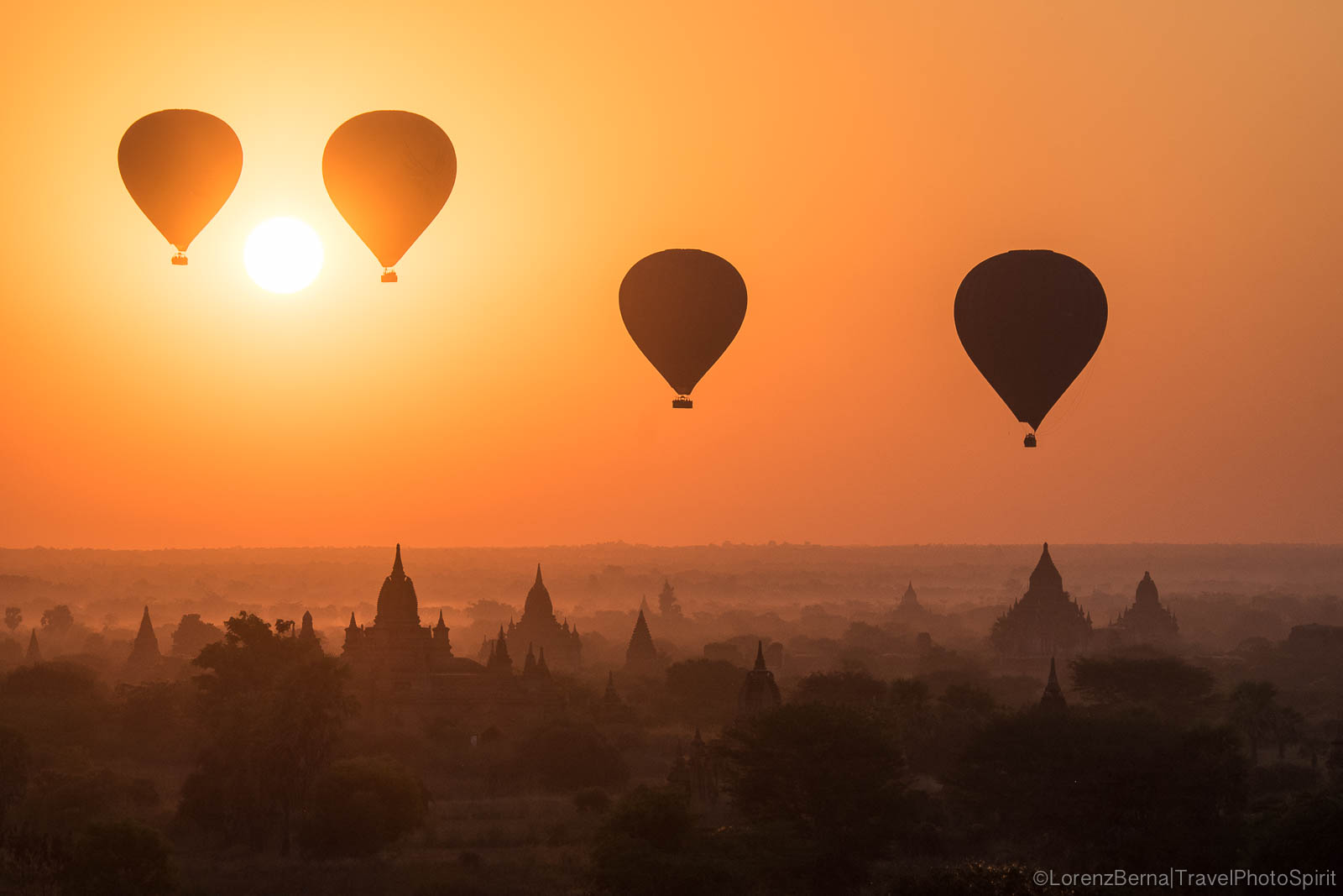 Air Baloons at sunrise over Bagan temple area - A Lorenz Berna Travel Photography of Myanmar