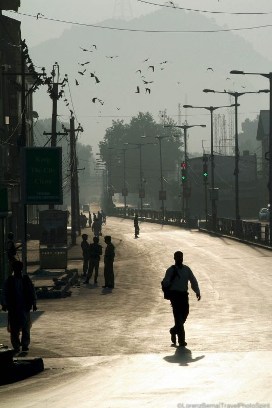 Silhouette in the morning lights in a street of Srinagar, India