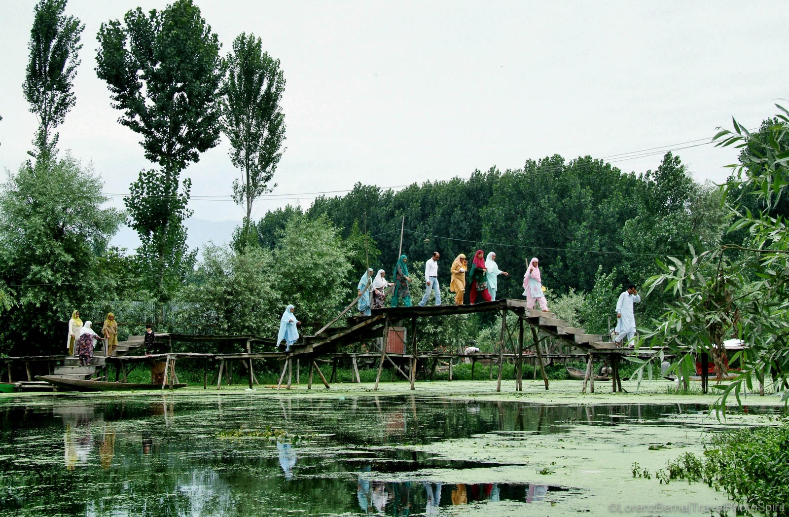 People crossing a small bridge over the canals in Srinagar, Kashmir, India