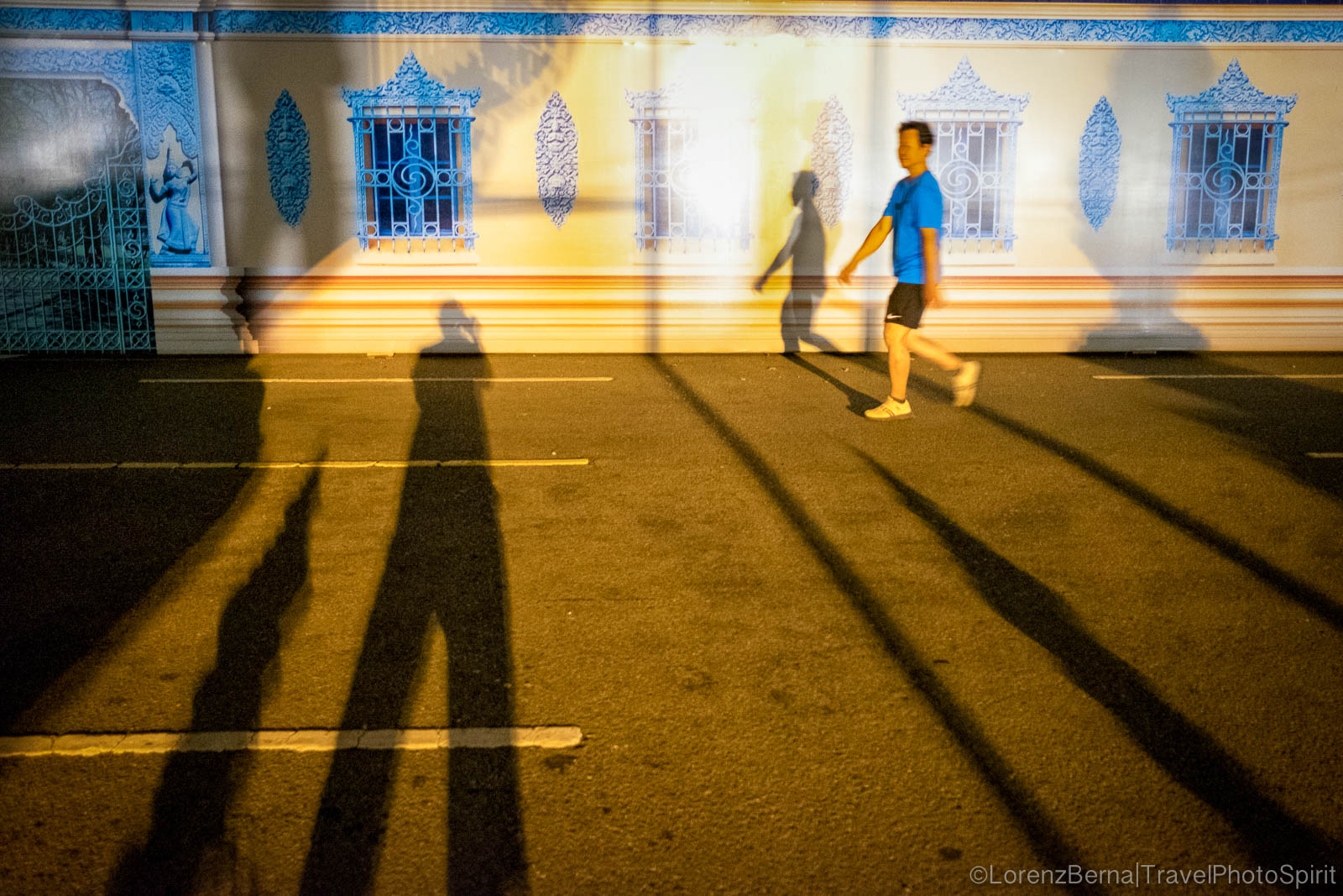 Shadows alongside the Royal Palace in Phnom Penh, Cambodia