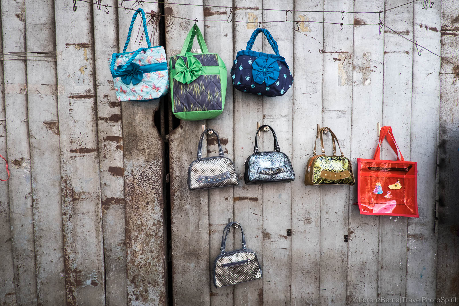 Street stall of women handbags.