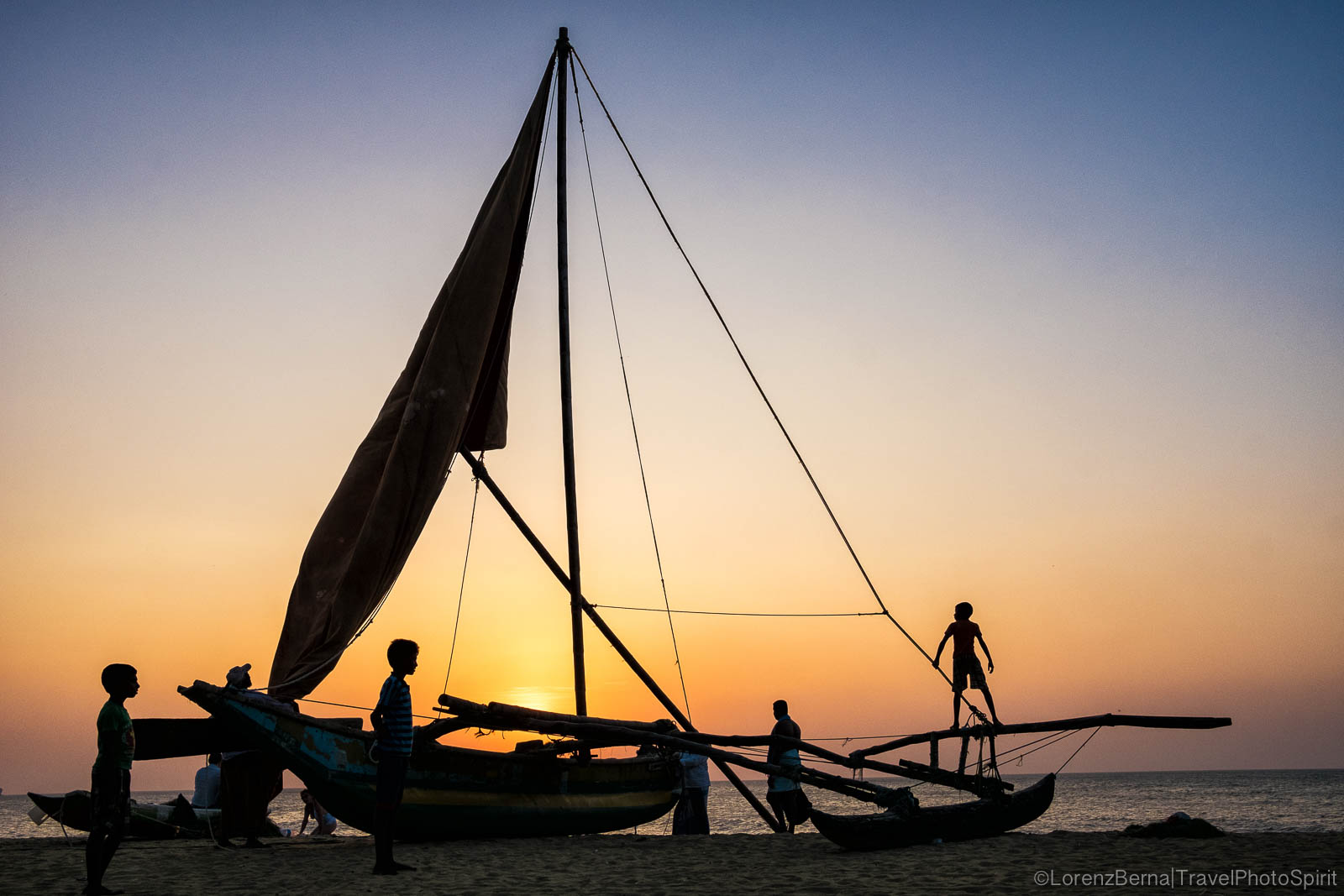 Childen playing on a sailing boat standing on Negombo beach at sunset - A photography of Sri Lanka by Lorenz Berna