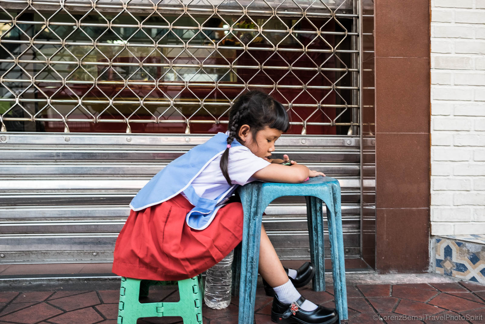 Homework time in Bangkok streets.
