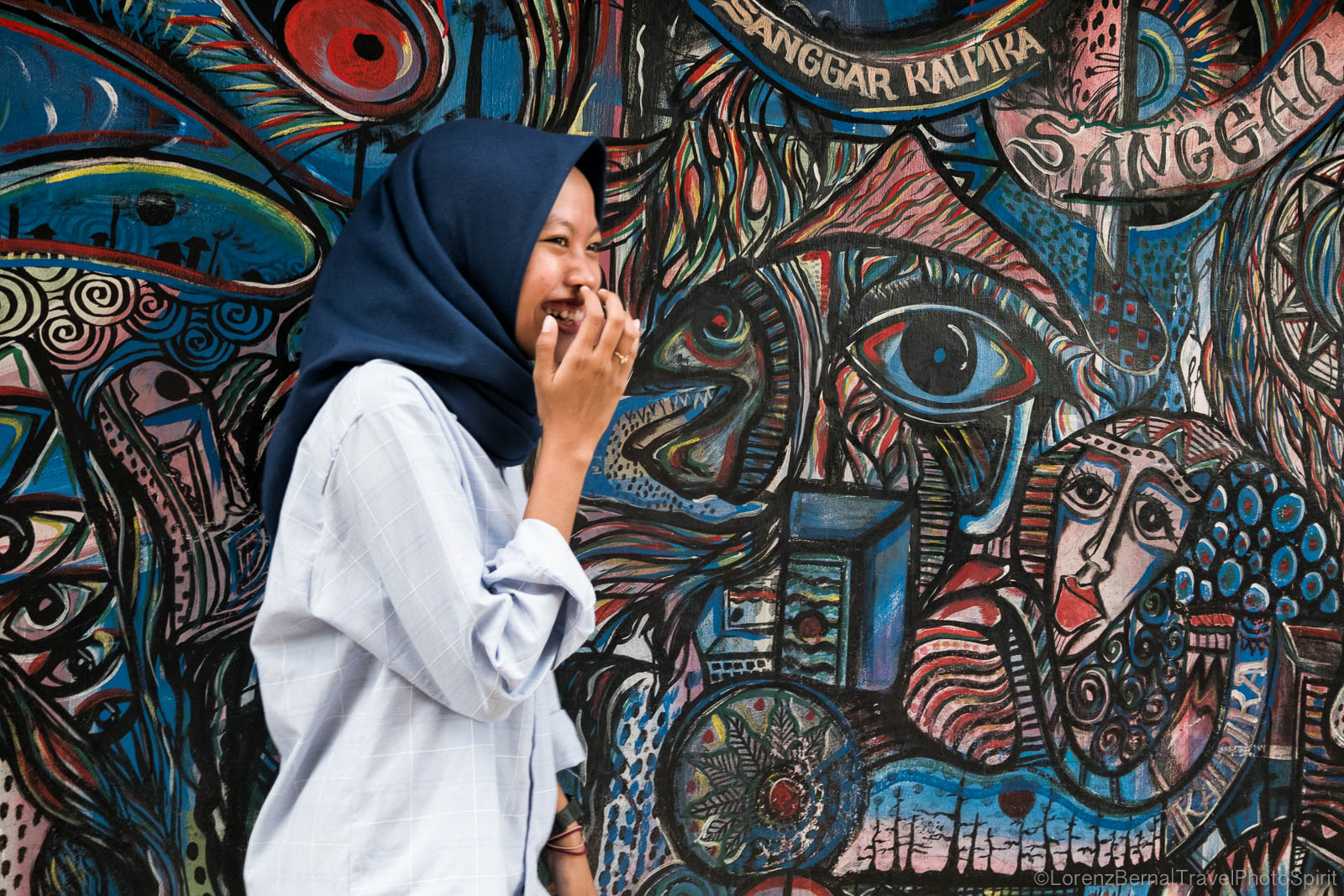 Javanese modern girl in front of a graffiti wall in Yogyakarta, Indonesia.