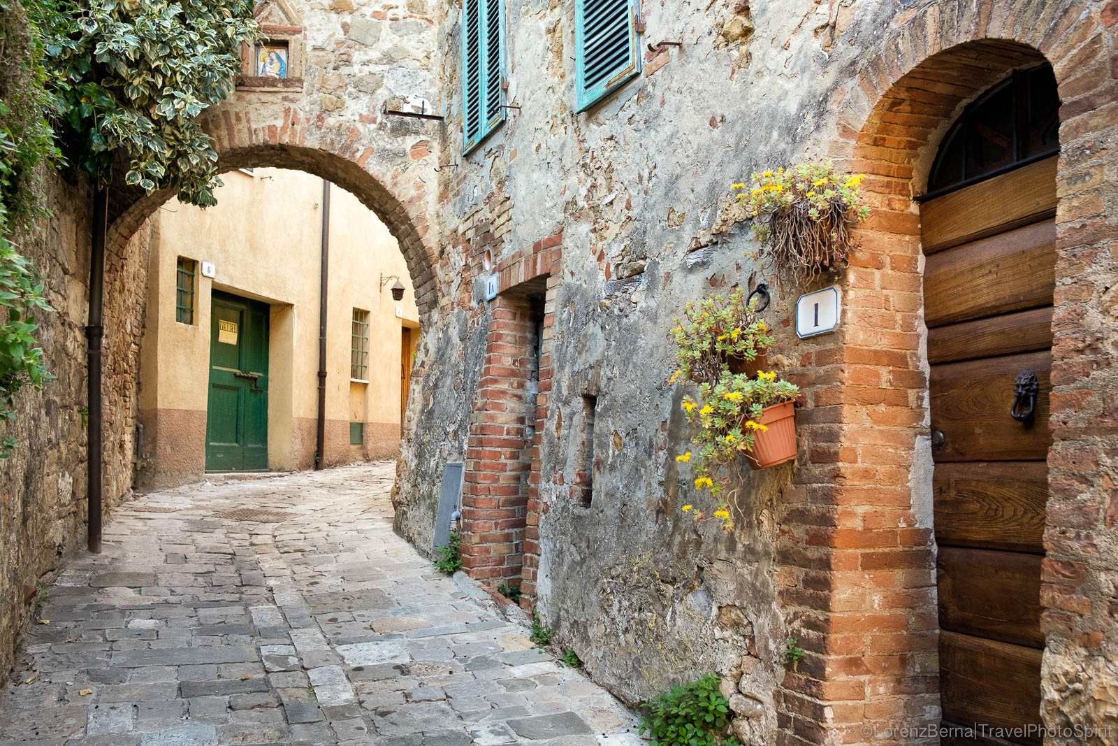 Old street in a classic Tuscany village, Italy.