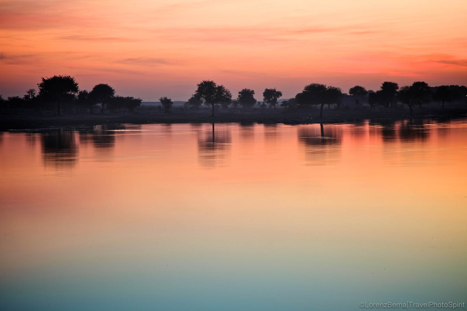 Sunset colors reflecting on Gadisar Lake, Jaisalmer - A Lorenz Berna Photography of India