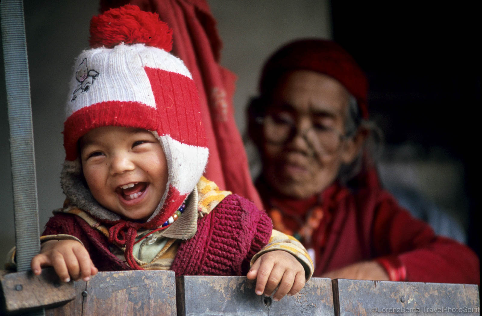 Baby with his grandmother i Gurjung village, on Annapurna Trail in Nepal Himalayas - Travel Photography by Lorenz Berna