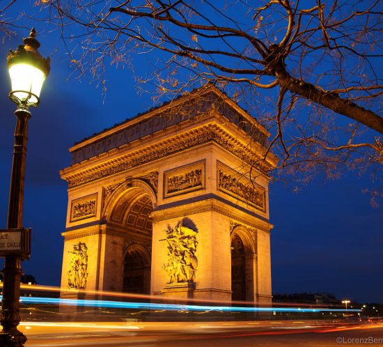 Long exposure picture on the parisian Arc de Triomphe by night.