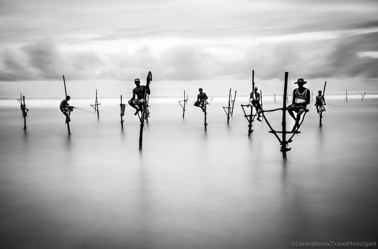 Traditional fishermen on stilt, in Weligama - A photography by Lorenz Berna of Sri Lanka
