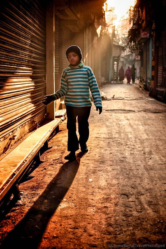 Child walking in the Morning lights in the streets of Old Delhi, India