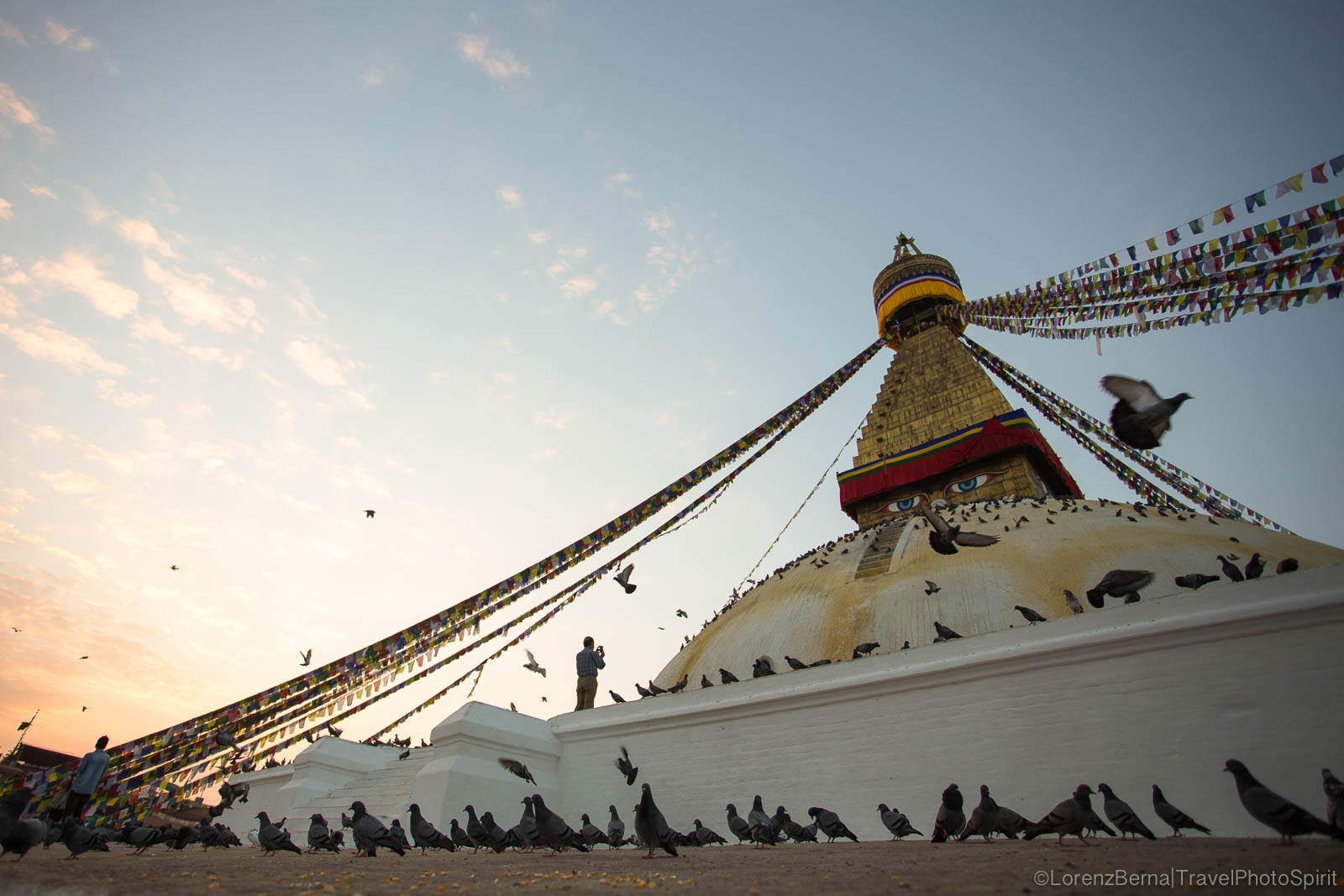 Boudhanath Stupa at sunrise : the first devotees are praying, in Kathmandu, Nepal.