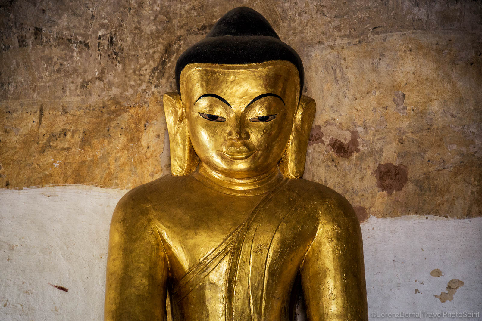 Golden statue of Buddha in a temple of Bagan.