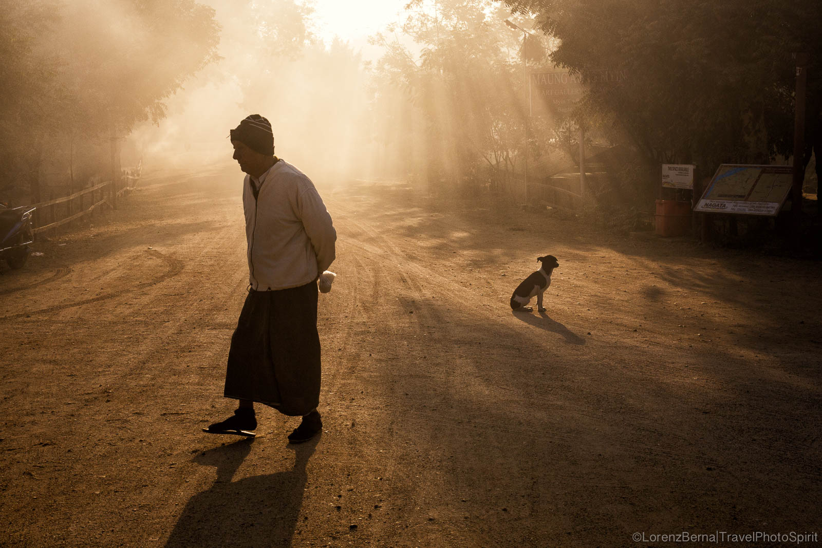 A man and a dog in the backlights : Street scene in the villages around Bagan, Myanmar