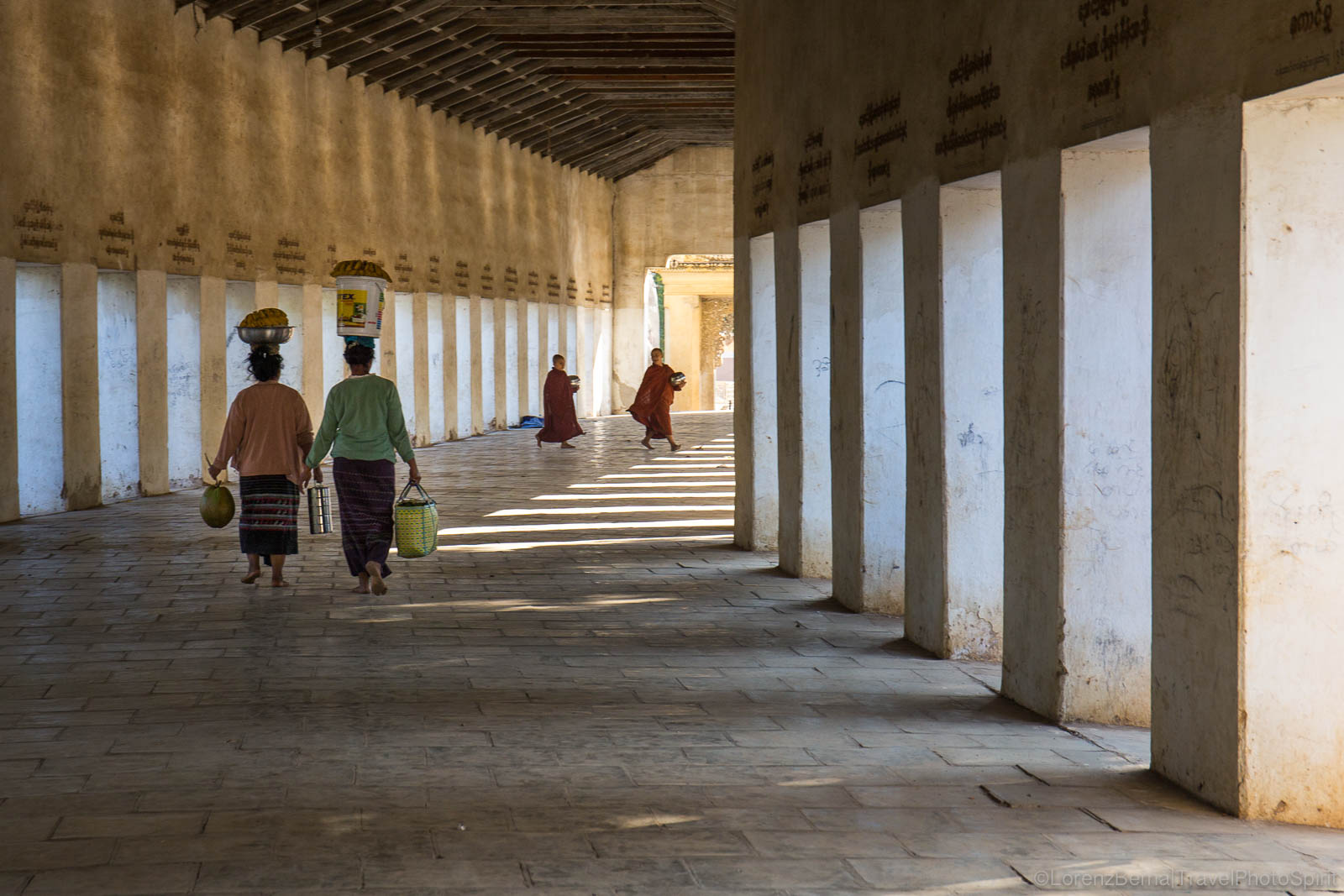 Local people and monks in the long walkway leading to Shwezigon Pagoda.