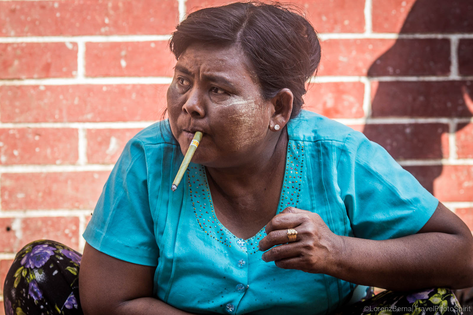 Burmese woman smoking local tobacco.