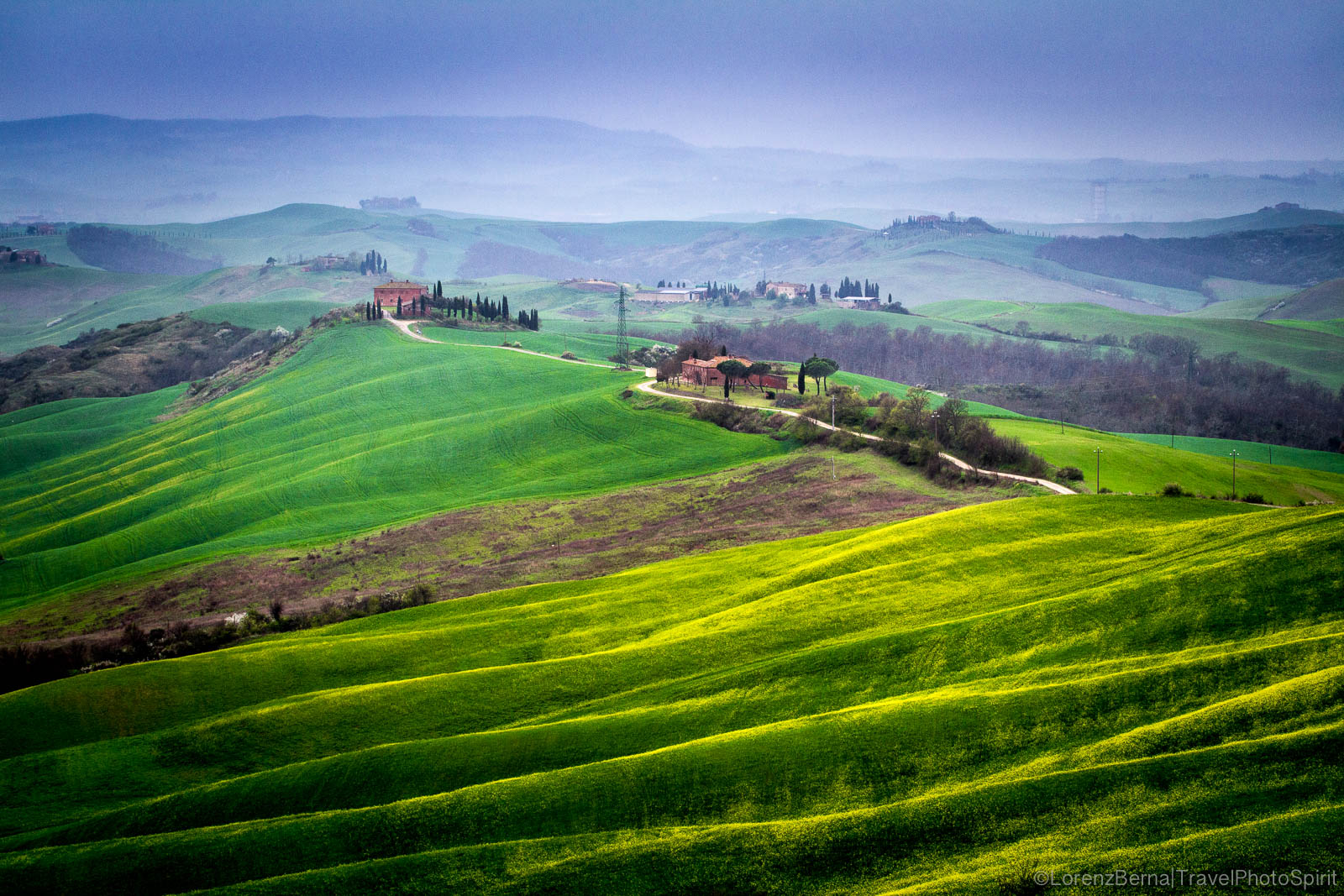 Spring colors on an open valley of the Crete Senesi, Tuscany, Italy