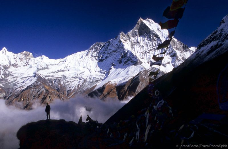 Silhouette of a man standing in front of the Machapuchare Mountain, from the Anapurna Base Camp - Travel Photography of Nepal by Lorenz Berna