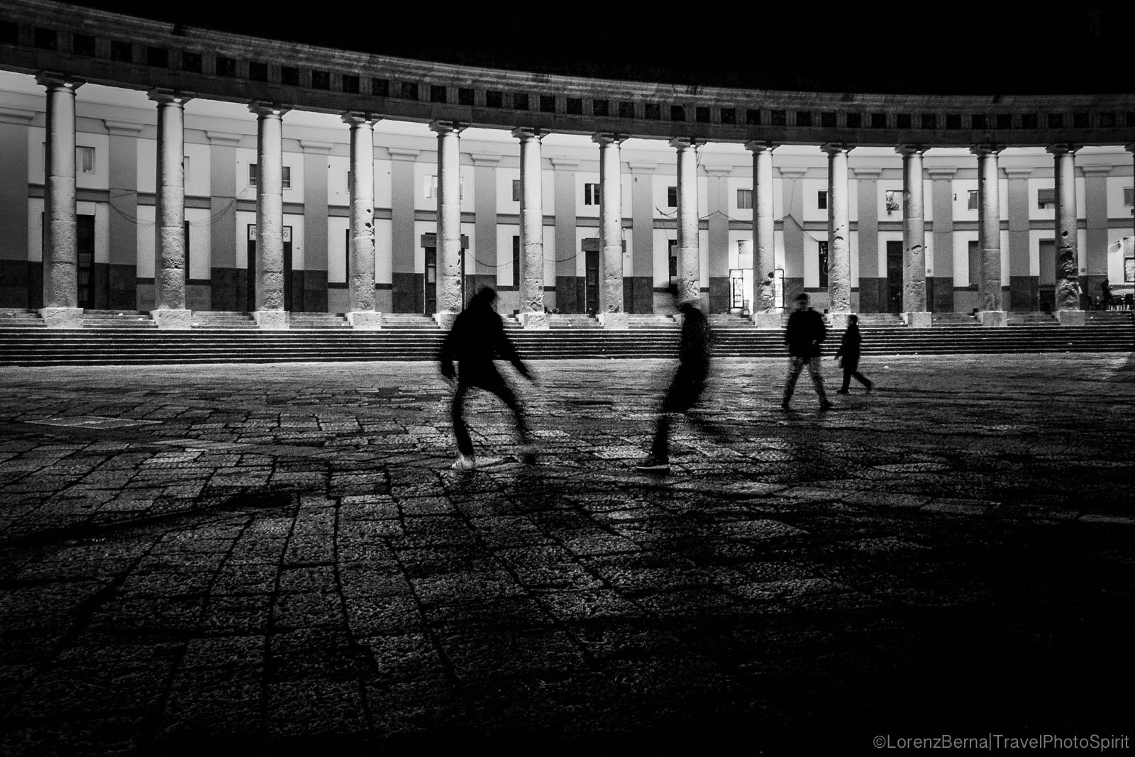 Football in Piazza del Plebiscito, Naples, Italy.