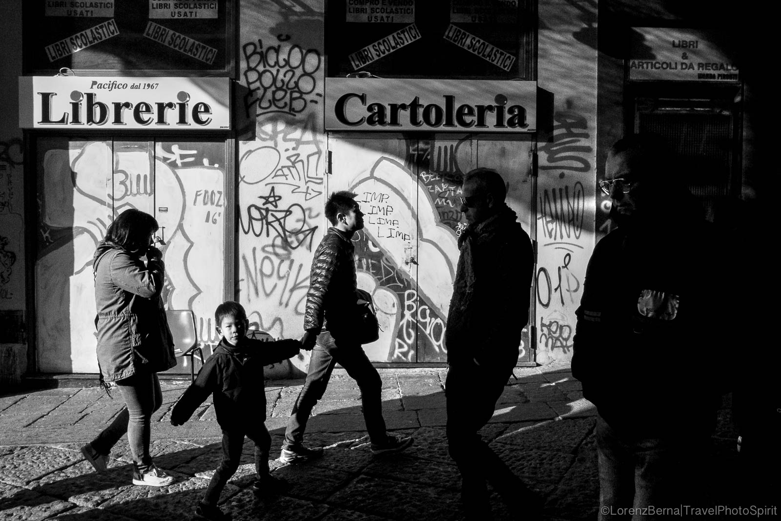 Passers-by in the streets of Naples on a Saturday afternoon, Italy.