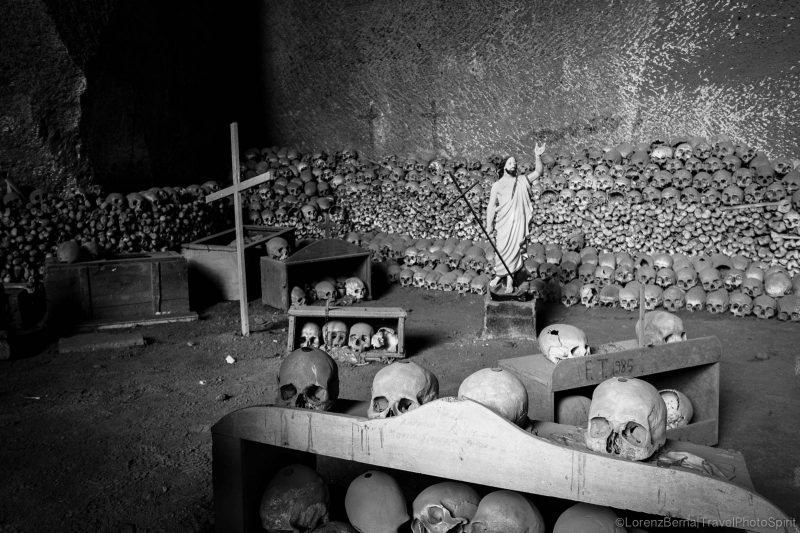 stacked skulls in the Fontanelle Cimetery in Naples, Italy