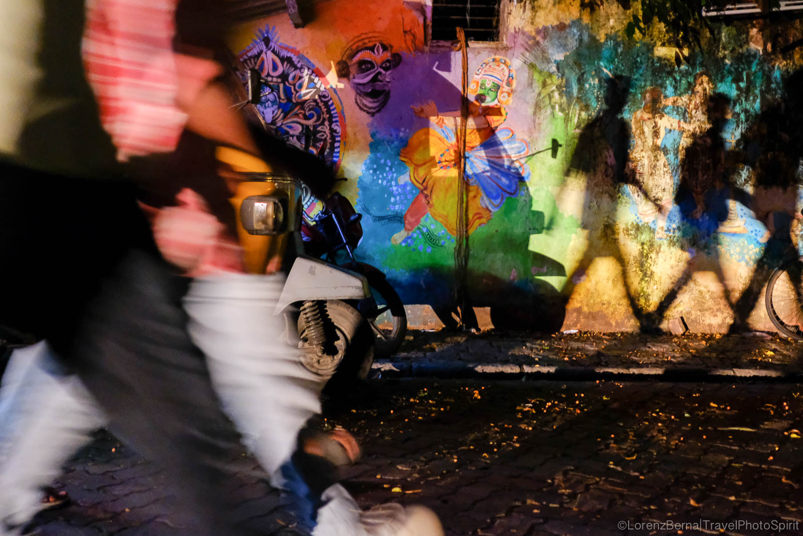 Street Photography : Shadows against a colorful wall in the night - A Lorenz Berna Photography of India